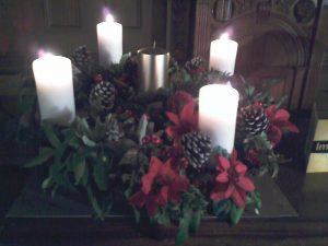 Advent wreath with four lit candles