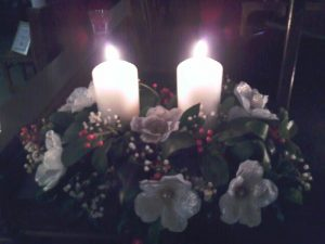 two candles in floral decoration