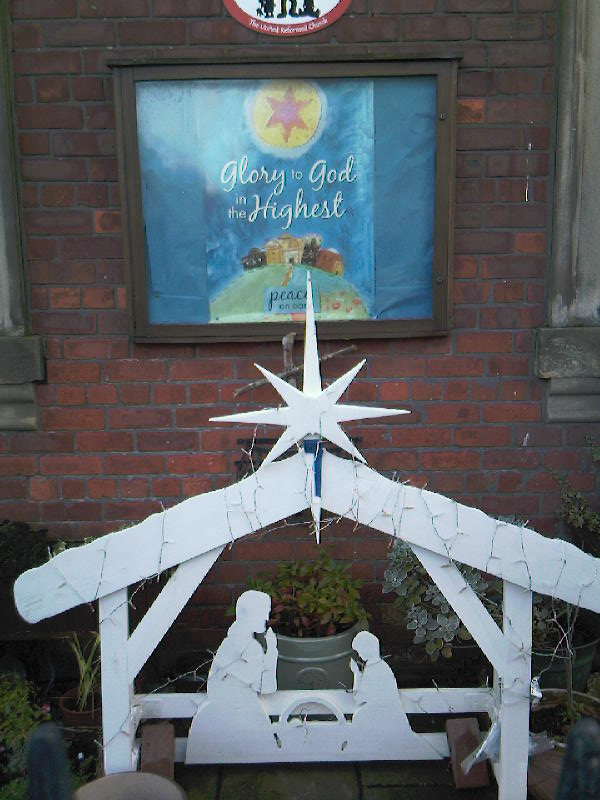 Wooden Nativity in the church garden