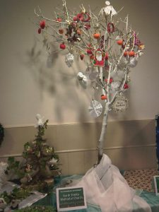 sprayed tree with paper decorations and poppies