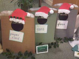 cardboard recycling bins with Santa hats