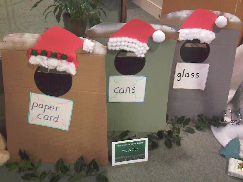 cardboard recycling bins with Santa hats